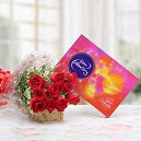 12 red roses bouquet with Cadburys celebration box